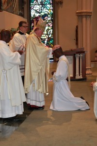 Bishop McManus ordains Father Wilmar Ramos  to the priesthood.  Photo by Tanya Connor