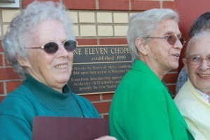 Sisters of Mercy gather by their plaque at One Eleven Chophouse in Worcester Friday. From left are Sister Carol Kell, a volunteer at McAuley Nazareth Home for Boys in Leicester; Sister Anna Jarkowsky, who serves the community in New York, and Sister Mary Daniel Malloy, staff psychologist in the Worcester Diocesan Judicial Vicar's Office
